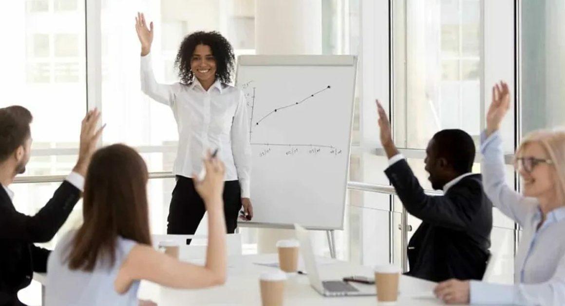 Employees raising their hands